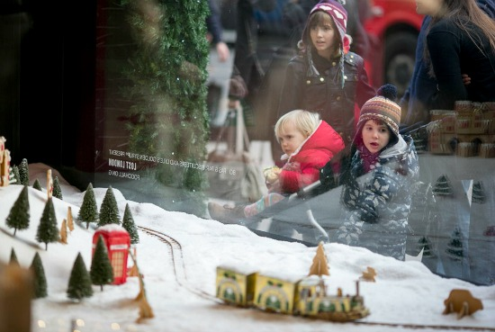 Kids looking in show window at Christmas display