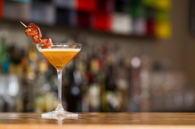 Cocktail with bacon garnish